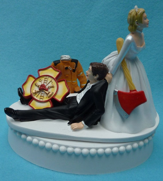 Woman Dragging Firefighter Cake Topper