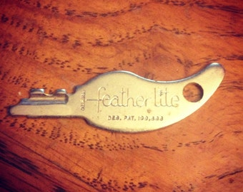 Vintage 1970's stylized Featherlite Key.