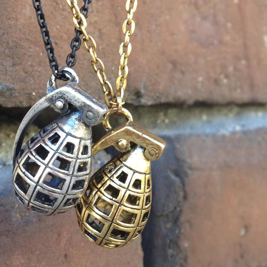 gold and silver grenade necklace set by crystalcompass on etsy