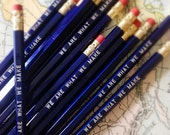 We are what we make pencil 6 pack in metallic blue. Made in USA.