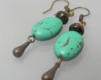 Path walkers. Turquoise howlite, bronzite and brass teardrop earrings.