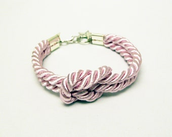 Shiny light pink forever knot nautical rope bracelet with silver star charm