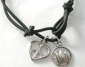 Silver Lotus and Heart Charms on Black Rubber Bracelet
