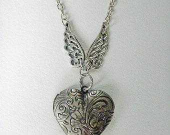 Silver Heart Locket with stunning filigree wings