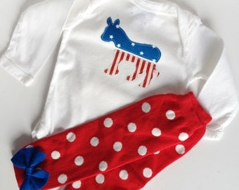democrat donkey long sleeve one piece with red and white polka dot baby leg warmers with blue bow