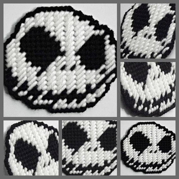 Plastic canvas big black eyes and white skull skeleton head with black evil smile grin small magnet