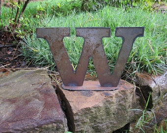 """Lowercase metal letter """"w"""" on stand. Metal art handmade for you."""