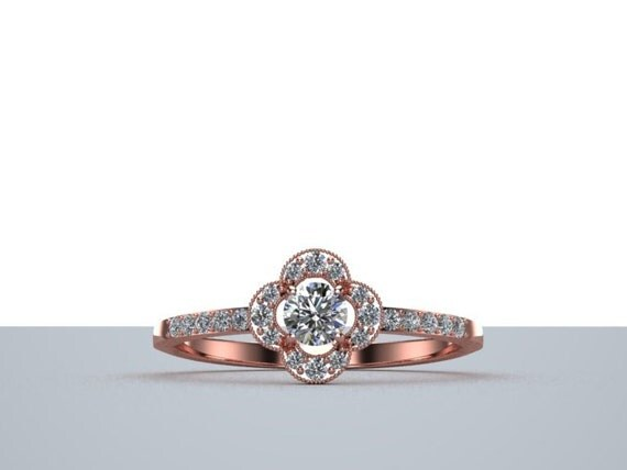 dainty engagement ring with halo in gold