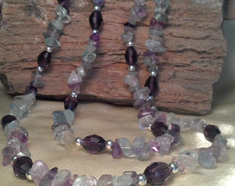 Lovely Long natural florite gemstones with swarovski crystals and silver beads.