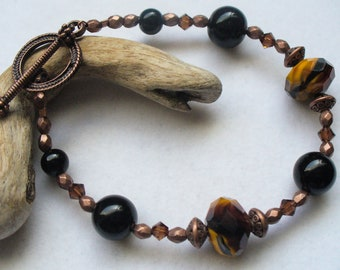 Handmade Rustic, Southwestern Beaded Bracelet with Amber, Brown and Black Glass Beads, Black Stone and Swarovski Crystals for Fall, Autumn