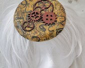 Steampunk Gears and Cogs on a number print Circle Saucer Pill Box  Hair Fascinator Hat worn with elastic headband