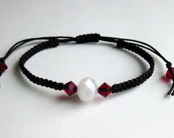 Black Macrame Bracelet with a Single White Alabaster Crystal and Siam Red Swarovski Crystals