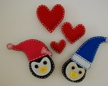 Felt magnets, Felt penguin magnets.