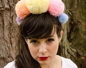Giant PomPom Crown. Handmade Yarn pompom jewelry headband. Pom Pom hair accessory. Pastel. Pink, Purple, Peach, Light blue and soft yellow.