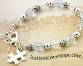 Silver Puzzle Piece Charm Bracelet for Autism and Asperger's Awareness with Light Sapphire and Clear Crystals - LBCAB