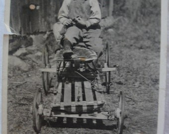 vintage photo proud boy with go cart