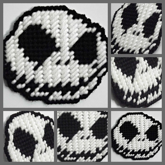 Plastic canvas big black eyes and white skull skeleton head with black evil smile grin small magnet