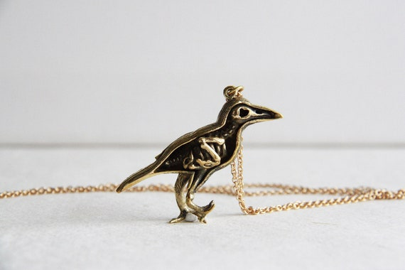 An Anatomy skeleton of a Bird Necklace