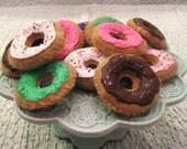 1/2 dozen felt donuts with sprinkles