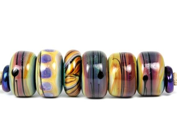 "Lampwork glass bead set handmade by Lori Lochner. ""Earthy RaKu Barrels"""