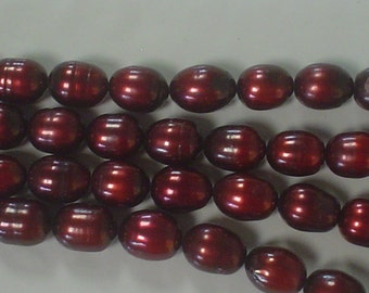 pretty fresh water pearl dark red wine rice (oval) 8 x 10 mm-9 x 11 mm/16 inch one strand