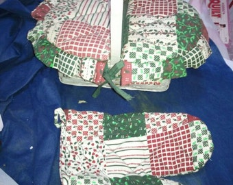 White wicker basket with hinged padded cloth lid ,lined with matching oven mitt. red green white