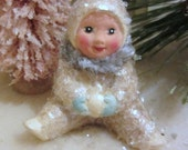 Snowbaby Sitting Holding Snowball with Silver Chenille Scarf