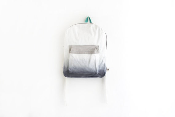 grey dyed backpack with light grey pouch