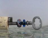 Vintage skeleton key with 2 lampwork beads