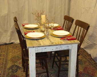 """Driftwood Dining Table (54"""" x 30"""" x 29""""H) with Antique white distressed bottom."""