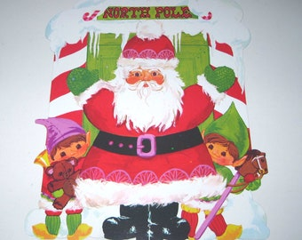 Vintage Christmas Die Cut Santa with Elves and Toys at North Pole