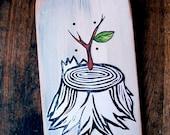tree stump with sapling