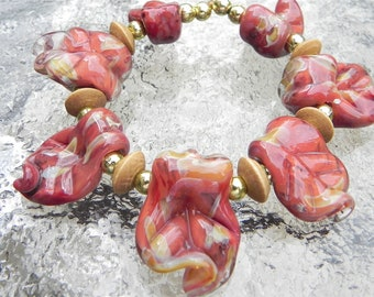 SALE-Hand made boro leaf beads set of seven, Orange and Gold by Misty Creek Studio Artist Terry Sieber