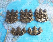 SALE! 11 vintage curvy distressed brass metal pull handles*
