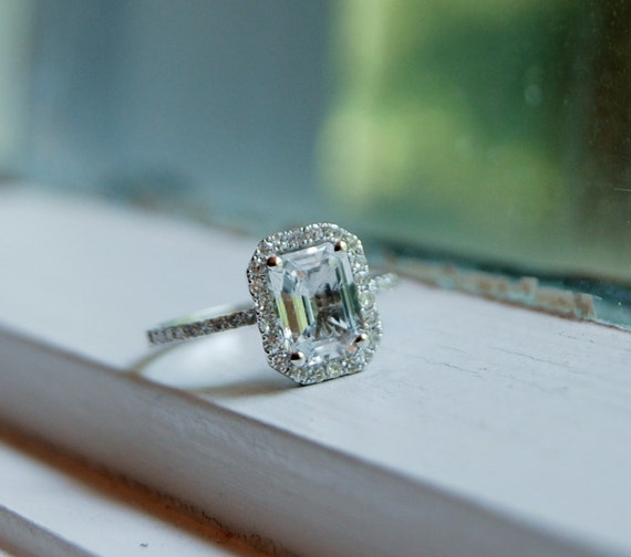 on hold until Monday-1.57ct emerald cut white sapphire in a 14k white gold diamond ring