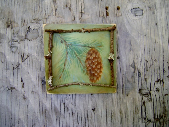 Painted Spruce Pine cone on wood plaque with twig detail