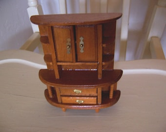 miniature wooden cabinet