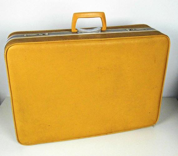 large mustard yellow suitcase