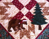 Christmas bear in the woods