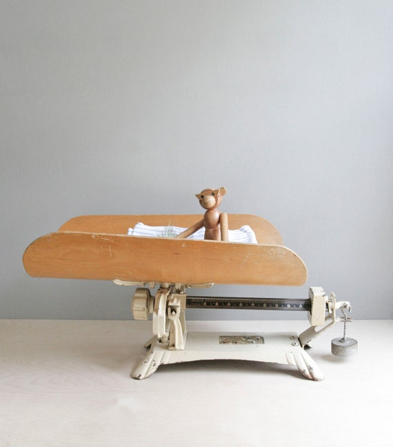 antique baby scale in pale cream