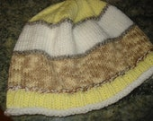 Yellow, beige and white hat