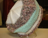 Hand knit pink, green, and white hat