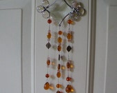 stained glass sun catcher beveled glass, peach/amber