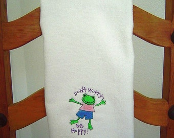 "VELOUR  Hand Towel --  with machine embroidered FROGGY and ""Don't worry be Hoppy"" wording."