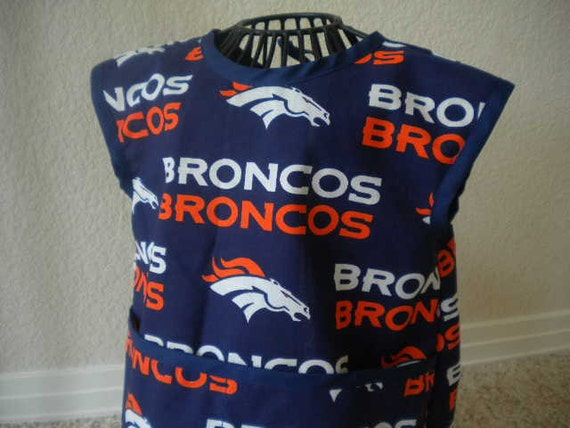 Broncos Art Smock or Apron with a Dark Blue Trim. Size 3t-4t.