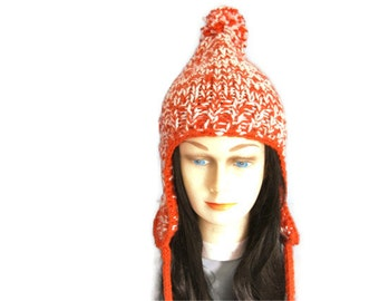 Hand knit orange unisex ski hat with cabled earflaps and pom pom -  acrylic chunky yarn - ready to ship