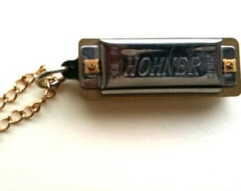 Harmonica necklace on gold chain... I've got the blues necklace