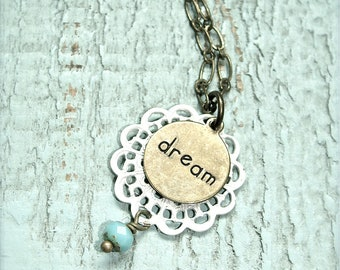 Dream.  Dainty inspiration necklace. Cream antique brass charm necklace with turquoise bead.
