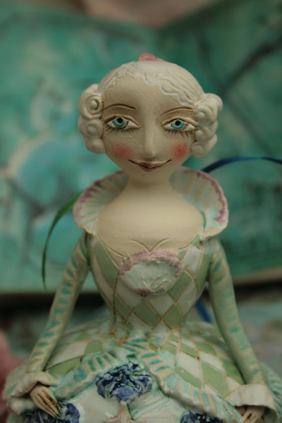 Girl in a baroque dress. Ceramic bell, sculpture.