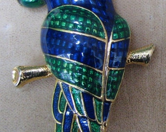A Parrot Pin in Deep Blues and Greens